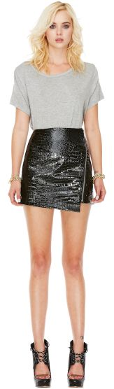 Asymmetric black leather skirt with zip