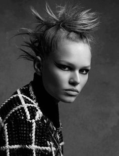 Edgy punk style: Mohawk hair + Graphic double winged eyeliner. Anna Ewers for Chanel fall winter 2015 Ad Campaign shot in black and white by Karl Lagerfeld.  Anna Ewers for Chanel fall winter 2015 Ad Campaign shot in black and white by Karl Lagerfeld.