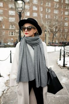 Chunky scarf, wide-brimmed hat, big sunnies