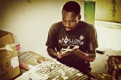 Talented Haitian artist making beads from Haitian clay from Papillon Enterprise