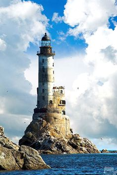 Ever wondered what a beautiful love story is that of a lighthouse and a sea? The lighthouse, Tall and statuesque, looks over the sea. And the mighty sea in all her glory swooshes around him. Lighthouse Pictures, Lighthouse Painting, Water Tower, Belle Photo, Beautiful Landscapes, Landscape Photography, Scenic Photography, Night Photography, Landscape Photos