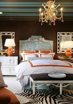 brown, teal, and orange bedroom -- very fun (love the rug) even though I would trade the orange for magenta!  And that ceiling!  Very fun!