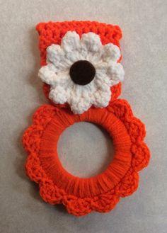Kitchen towel hanger orange crochet flower by Yarnhotoffthehook