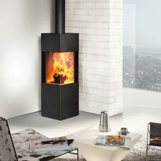 Austroflamm Slim Multifuel Stove -hubby likes the idea of a corner stove. Corner Log Burner, Wood Burning Stove Corner, Corner Stove, Log Burning Stoves, Corner Door, Home Fireplace, Fireplace Design, Fireplaces, Modern Log Burners