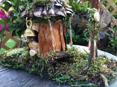 Lovely fairy cottage with brass bell and swing by ChezDarlington Brass Bell, Beautiful Fairies, Clothes Line, Pine Cones, Bird Feeders, Wind Chimes, Unique Gifts, Fairy, Cottage