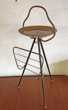 This is a very interesting piece of MCM design. It is a brass atomic side table, with a ceramic top, and magazine rack. Dare I say it, but i...