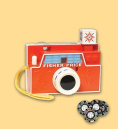 Fisher Price Picture Disk Camera.    http://hoptoyshop.co.uk/childrens/-Imaginative-Play/4707/Classic-Fisher-Price-Fisher-Price-Picture-Disk-Camera/