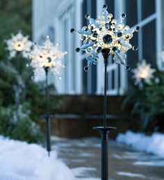 Solar Snowflake Stakes, Set of 2 | Outdoor Holiday Decorations | Our sparkly, bejeweled Solar Snowflake Stakes look charming by day and glow after dusk. Each solar snowflake in this set has a flocked snow look and is wonderful to illuminate a pathway, drive or flower bed.