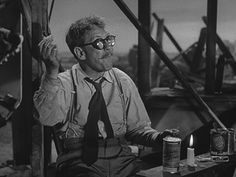 """Henry Bemis (Burgess Meredith) enjoys a little lunch in TZ's """"Time Enough at Last."""""""