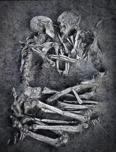 Many years from now, I hope they dig. And when the soil and sediment and layers of time have been lifted, I hope they find my skeleton intertwined with yours. My dusty skull resting against yours. ~TKG