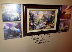 My Disney wall in the front hallway...Thomas Kinkade Disney pieces.