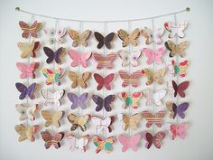 Love the idea of butterfly garland for a future girls room | Shop. Rent. Consign. MotherhoodCloset.com Maternity Consignment