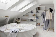 This attic dressing room is beyond dreamy.