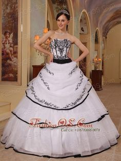New White Quinceanera Dress Strapless Organza Embroidery Ball Gown  http://www.fashionos.com  http://www.youtube.com/user/fashionoscom?feature=mhee  This beautiful white and black Quinceanera dress would make any girl feel like a Princess on her Quince day with it's exquisite design and details. Made out of Organza, this strapless Quinceanera dress features a strapless bodice that is accented with lovely sweetheart neckline and gorgeous embroidery.