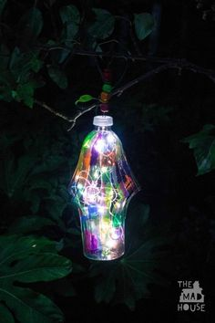 DIY Garden lantern from a plastic bottle Turn your trash to treasure with this DIY Garden lantern - This is a fantastic DIY craft for upcycling plastic bottles. http://www.muminthemadhouse.com/diy-garden-lantern-plastic-bottle/