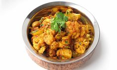 This Punjabi potato and cauliflower curry is now a prized dish across India and Pakistan. But for the best texture, should the potatoes be waxy or floury? And which spices bring out its comforting warmth?