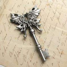 Steampunk skeleton key Winged pendant Art Nouveau PEWTER. $11.95, via Etsy.