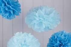 Pack Of Five Blue Tissue Paper Pom Poms from notonthehighstreet.com