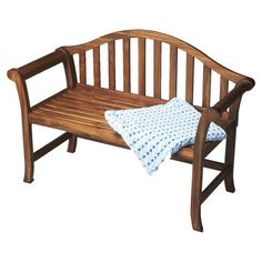 Arched wood bench in cinnamon with a slatted back.   Product: BenchConstruction Material: WoodColor: ...