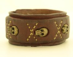 Distressed Burgundy Leather Cuff with Bronze Skulls, Sewn – Memento Mori