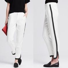 [Banana Republic]piped white drapey pant This are killer tapered drapey pants with piped detailing. Details: zip fly with hook-and bar closure, front off-seam pockets, rear welt pockets, dolphin cuffs. 100% Lyocell. Size: 6S. No PayPal + No Trades. Banana Republic Pants Ankle & Cropped