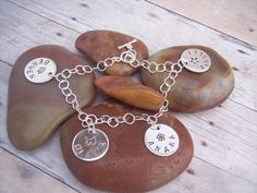 Hand Stamped CHARM BRACELET Sterling Silver. $79.00, via Etsy.  For each Foster Child's name?