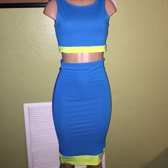 Two Piece BodyCon Set Get this sleeveless crop top with matching midi skirt. The set is ocean blue and with lime trimming in the front and in the back it is Royal blue with lime trimming... This is a fairly new set it was worn once and kept well. Other