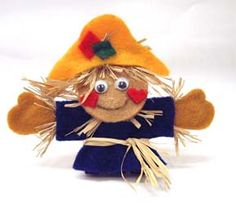 Felt scarecrow pin (or magnet). If you're making this with a child, make the felt pieces larger and maybe prepare little bunches of raffia in advance.