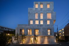 Built by Hiroyuki Ito Architects in Setagaya, Japan with date 2014. Images by Makoto Yoshida. This is an apartment building which contains ten units including duplex apartments. As a variety of households are li...