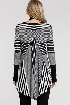 """Stripes are always in fashion and this season we have taken them a bit further in this a line swing tunic. A fabulous piece for layering under coats or longer jackets that offers great coverage. Features: - Knit stripe - Fit and flair - Crew neck - Long sleeves with deep contrast cuffs Size & Fit: - Semi fitted - Our model's height is 178cm (5'10"""")(some garments have been lengthened to accommodate models height) Fabric Composition: Main: 95% Polyester 5%..."""