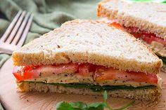 Roasted garlic hummus, tomato, and spinach make a perfect flavor pairing.