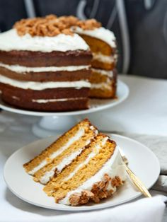 Pumpkin Tiramisu Layer Cake Recipe - Top moist pumpkin-and-spice cake layers with rich mascarpone cream and crunchy amaretti cookies for a seasonal dessert your Thanksgiving guests won't soon forget.