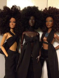 These barbie dolls look like Black Panthers with their all black attire and big afros. If you look closely, one of the dolls even has a nose ring in. They also vary in skin color.