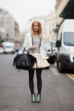 A not so ordinary corporate attire. A nice blazer then have some fun with a tutu skirt over tights. So cute :)