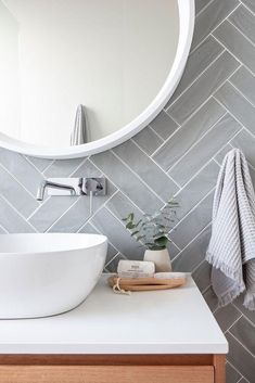Get the look: Contemporary vs. coastal bathrooms - badezimmer // bathroom - Double herringbone tile pattern – use conventional tiles but more modern feel than traditional su - Bathroom Renos, Budget Bathroom, Laundry In Bathroom, Bathroom Pink, Bathroom Subway Tiles, Toilet Tiles, Cozy Bathroom, Bathroom Plants, Mirror Bathroom