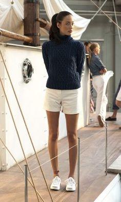 Spring fashion   Dark grey turtleneck sweater, white shorts, sneakers, ponytail