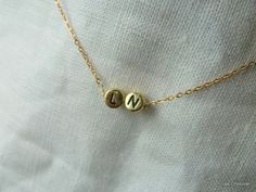 Tiny gold 2   letters necklace - Gold   initial necklace in  your choice. $14.00, via Etsy.