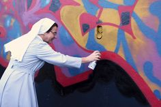 The spray-painting nun on Christmas on BSA from Jessica Stewart in Rome #13from2013 http://www.brooklynstreetart.com/theblog/2013/12/25/13-from-2013-jessica-stewart-the-roman-nun-and-the-spray-can/ via @bkstreetart #streetart #aerosol #graffiti #skemeSkeme. Rome, Italy 2013. (photo © Jessica Stewart)