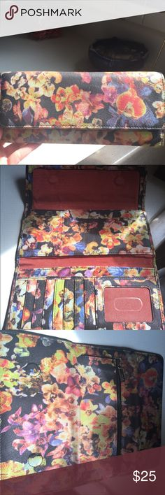Hobo brand floral trifold wallet Leather floral print hobo wallet. Trifold. 8 CC slots, 3 folds for cash money and one additional a lot for coupons, insurance cards, whatever you like! Love this wallet style. Roomy! HOBO Bags Wallets