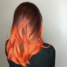 @kateloveshair is on fire We love this bright pop of color and the silky, shiny voluminous finish (girl can roundbrush!).#modernsalon
