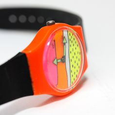 Vintage 80s neon color watermelon Swatch Watch in black, orange, yellow, green and pink. $105.00, via Etsy.