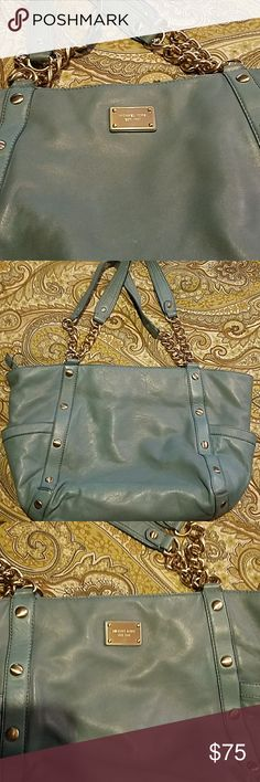 Michael Kors Shoulder Bag Michael Kors gold name plate with gold chain like fixture. Pretty color. This bag is in very good condition. Zip and non zip pockets on inside of purse. Pockets located on both sides of the purse. Michael Kors Bags Shoulder Bags