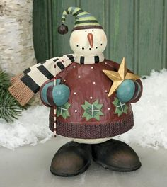 Snowman Holding Star and Candy Cane Figurine $30
