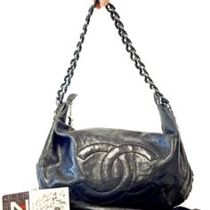 CHANEL LTd ED LUXE LIGNE/ CHAIN AROUND HOBO BAG Black distressed glazed caviar leather luxe Ligne chain around hobo bag. This bag was introduced in 2008 after the success of the Luxe Ligne line. bag features tonal stitching the the shape of CC. Antiqued silver chain woven throughout the circumference of the bag. Zipper top with logo CC zipper fab. Interior all leather w/ 3 compartments one large zipper w logo zipper pull other wall features a small pocket for lipstick or keys and add one for…