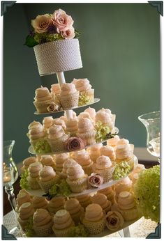Gigi's Cupcake on tier stand. Could be cute for a bridal shower if it was in my colors :)