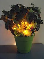 Burning Bush: Use orange Halloween lights to make this project.