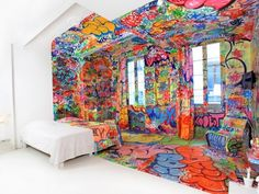 Panic Room  by Tilt    Now available for booking: a French hotel room is filled with colourful art you might typically find on the street.