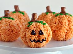 This Halloween, kids can have a hand at decorating these Pumpkin Rice Krispies Treats with whatever spooky face they want.