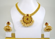 traditional gold necklace set with grand pendant