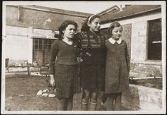 One of five refugee camps situated in factory buildings in Shanghai. Three Jewish girls pose in the Pingliang refugee camp. 1941